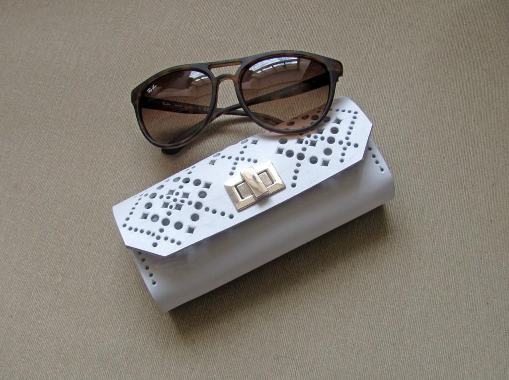 3 White leather sunglasses case