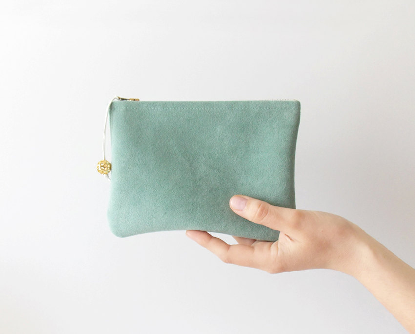 1 Mint suede clutch with a gold metal bead
